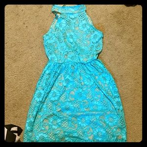Blue lace dress with nude lining underneath